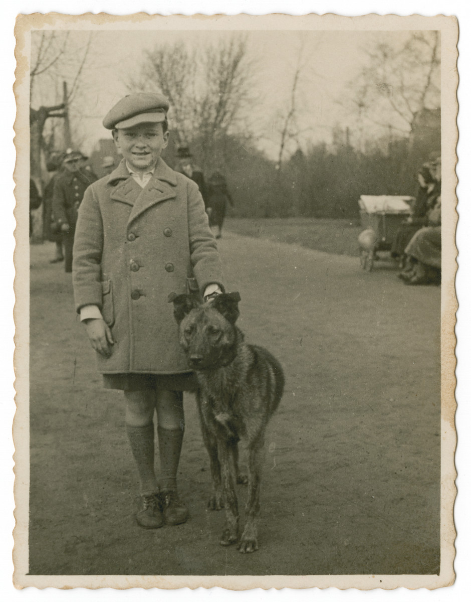 Stanislaw Aronson poses on a street with his dog,