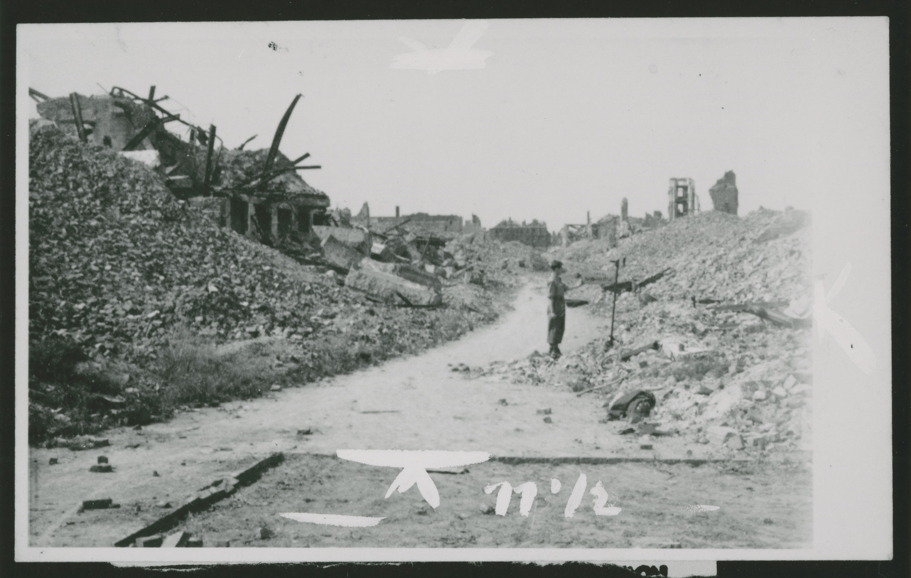 "Ruins of the Warsaw ghetto.  The inscription by George Kadish on the back reads ""A street in the ""stabbed"" Warsaw ghetto."""