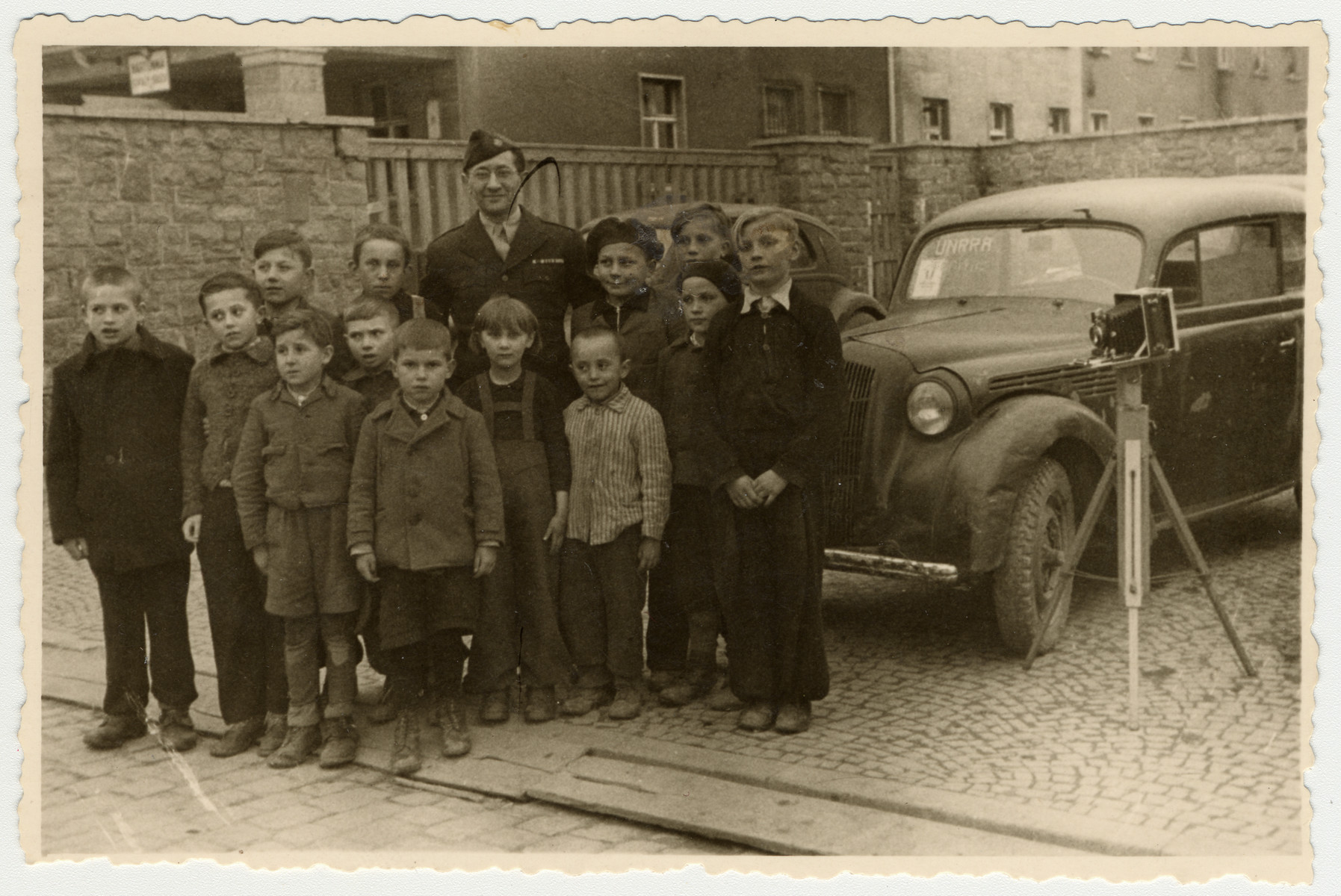 Mordecai Schwartz poses with a group of children in the Aschaffenburg displaced persons' camp.