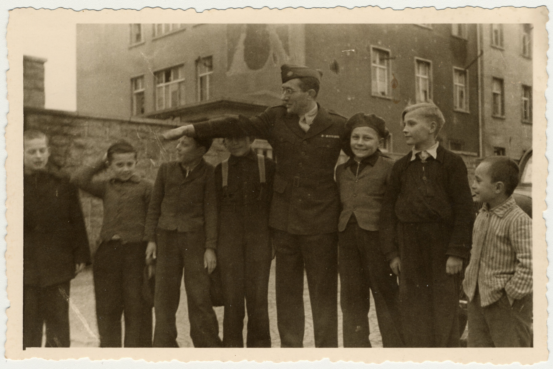 UNRRA director Mordecai Schwartz poses with a group of boys in the Aschaffenburg displaced persons' camp.