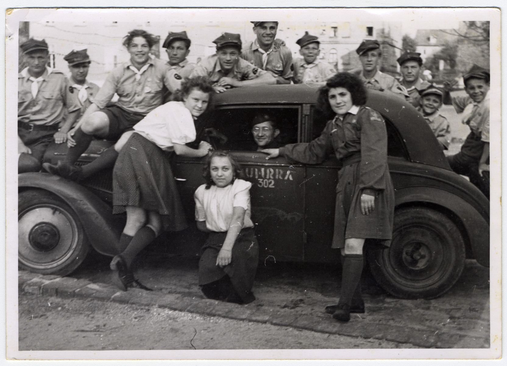 UNRRA director Mordecai Schwartz (pictured in the automobile) assists in the repatriation of Polish displaced persons.