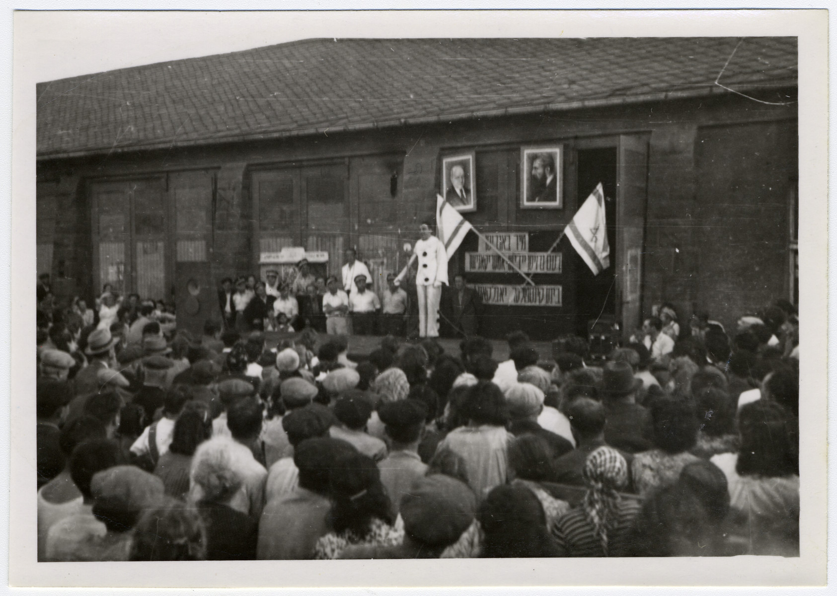 Jewish displaced persons celebrate the establishment of the State of Israel in the Munich displaced persons' camp.