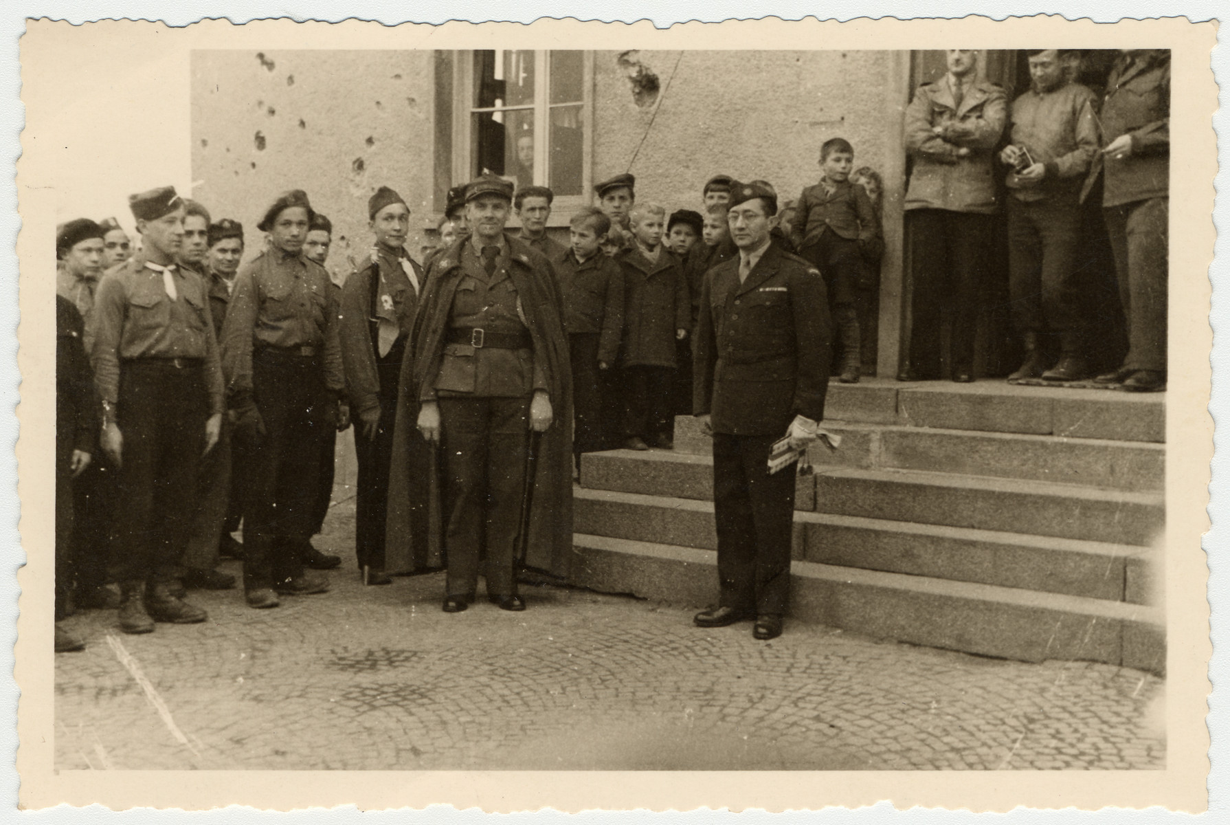 UNRRA director, Mordecai Schwartz poses with Polish displaced persons in the Aschaffenburg camp.