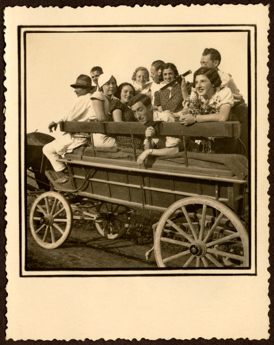 A group of Romanian Jewish youth go for an excursion in a horse-drawn cart.  Among those pictured are Sigmund Segal (front center), Adolph Fortes (top right), Miriam Segal Fortes (next to him, third from the right) and Ella Grossman (third from the left).