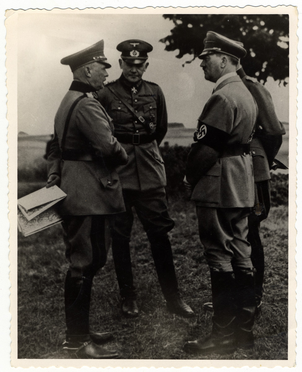 Adolf Hitler confers with his generals.