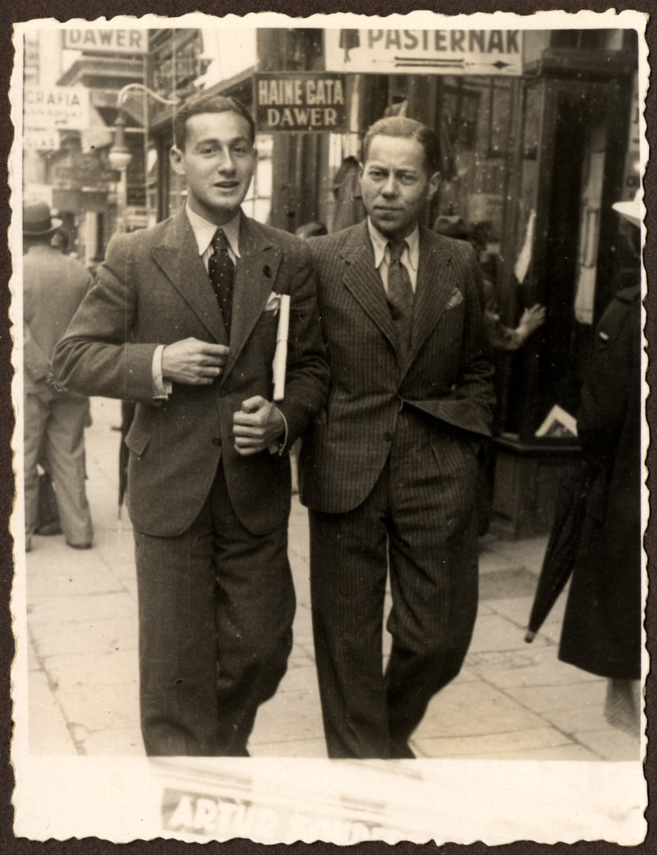 Two men walk down a street in prewar Cernauti.  Paul Grossman is pictured on the left, man on right was Ella Grossman's first husband, name not known.