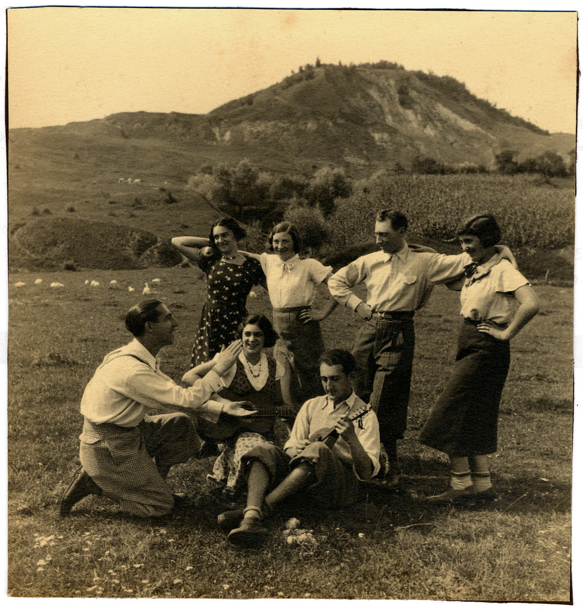 Romanian Jewish youth sing and dance to a mandolin in the Romanian countryside.  Among those pictured are (seated left to right): Siegmund Segal, Miraim Segal (unidentified). Standing: Adolf Fortes and Anna Segal (Grossman).
