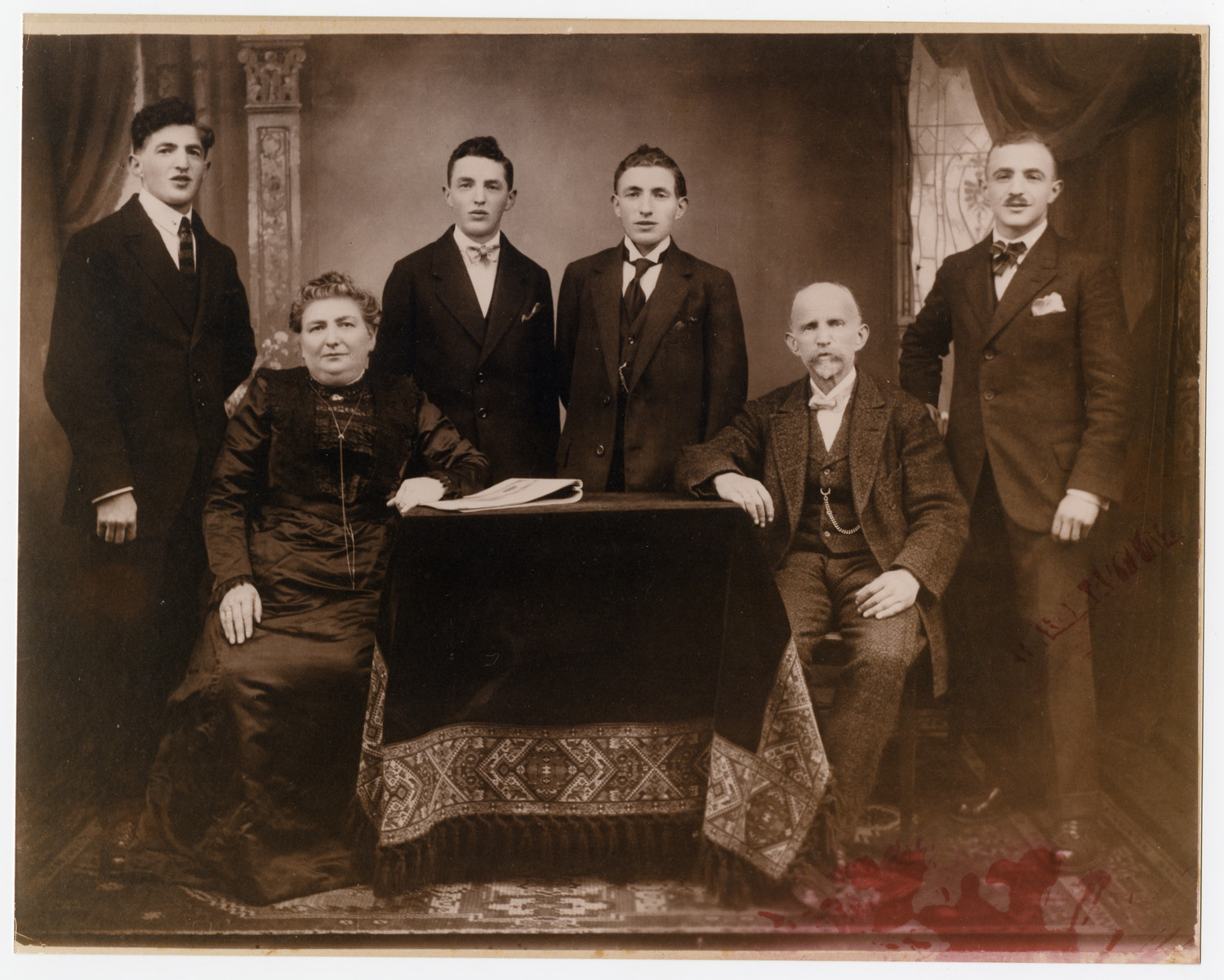 Studio portrait of the Zimmern family in Walldurn, Germany.  Seated are Bertha and Harold Zimmern.  Behind them are their four sons.  Julius (who immigrated to the United States before the Holocaust) is on the far left.  David (the father of the donor) is on the far right.  In the middle are Hugo and Leopold.