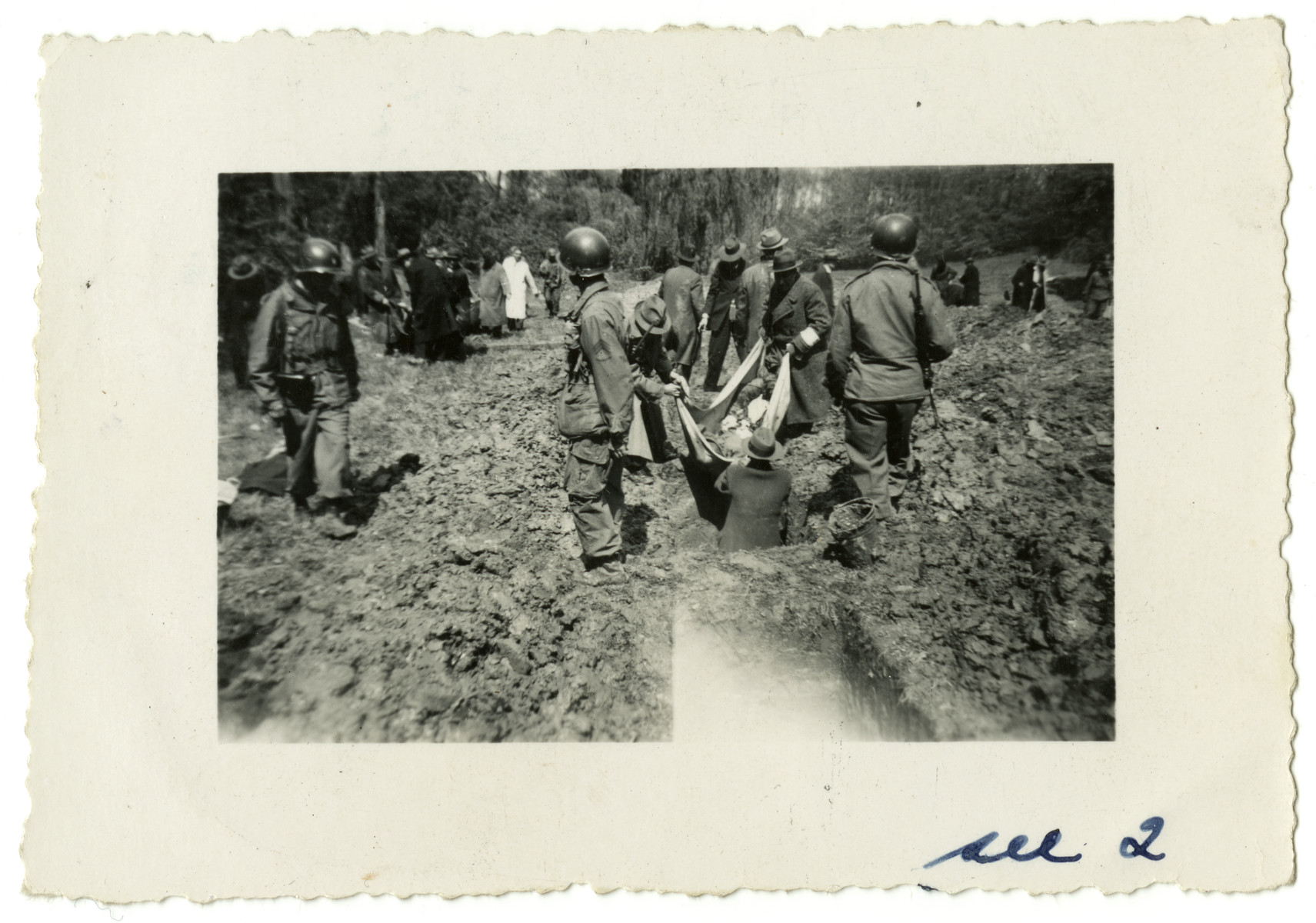 American soldiers force German civilians to exhume the corpses of slave laborers killed near Essen for proper reburial.