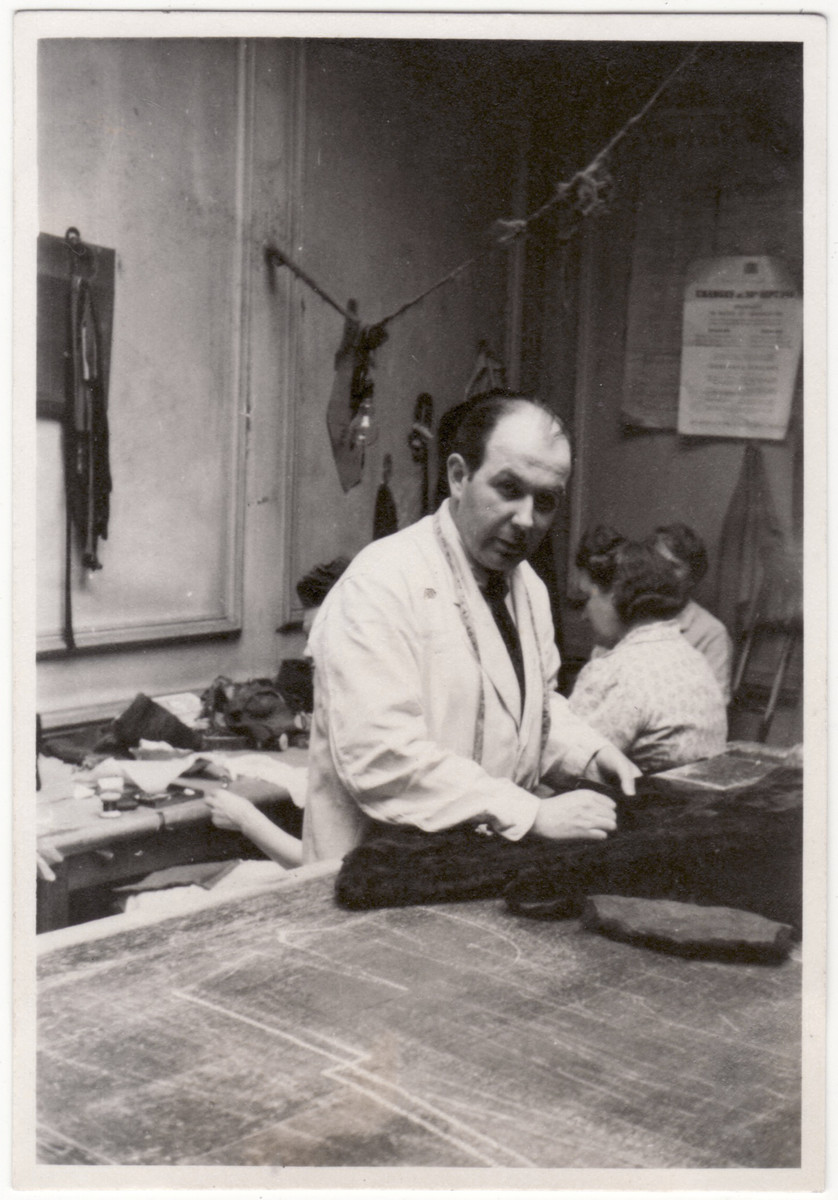 Sigi (Siegfried) Kulmann works in a workshop as a furrier.