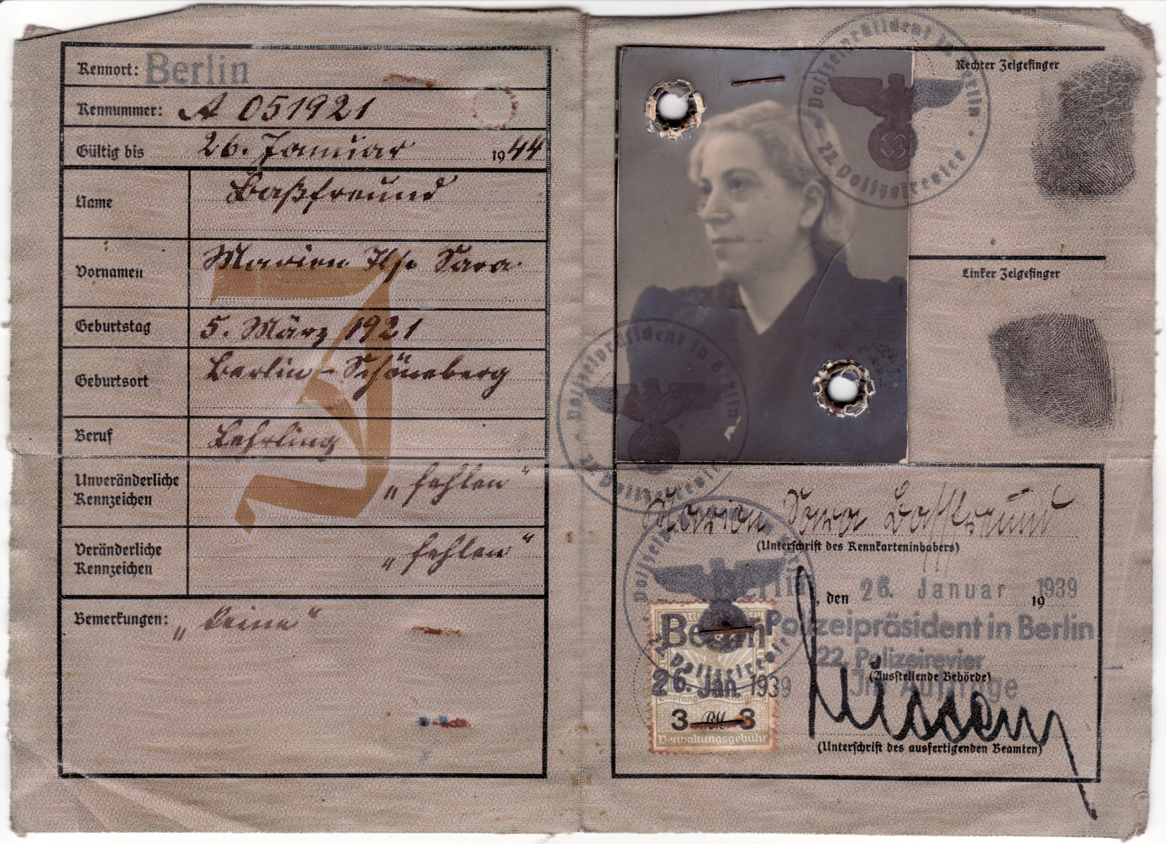 """Identification card issued to Marion Basfreund and stamped with a red J for Jude and the added middle name of """"Sara""""."""