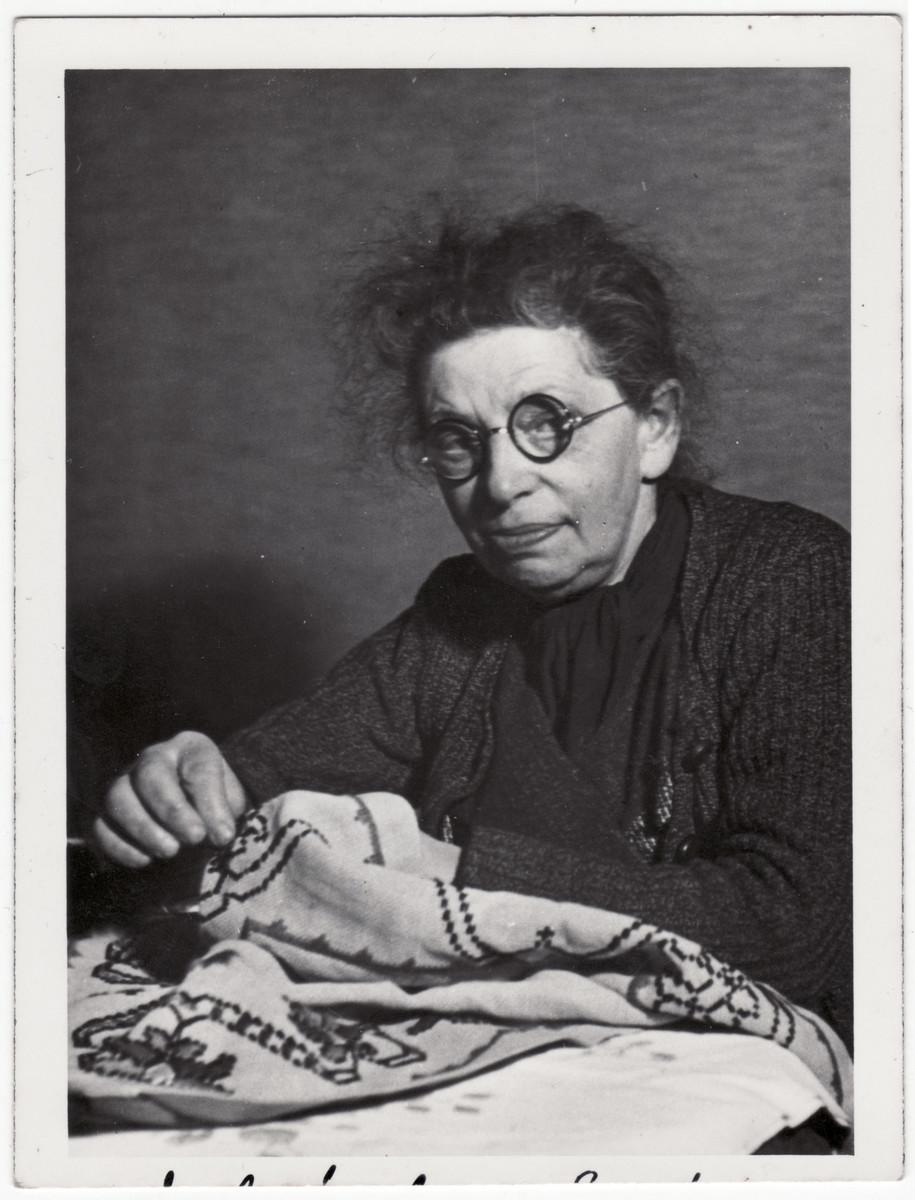 Adele Bassfreund, the sister of Ismar Bassfreund, embroiders a cloth.