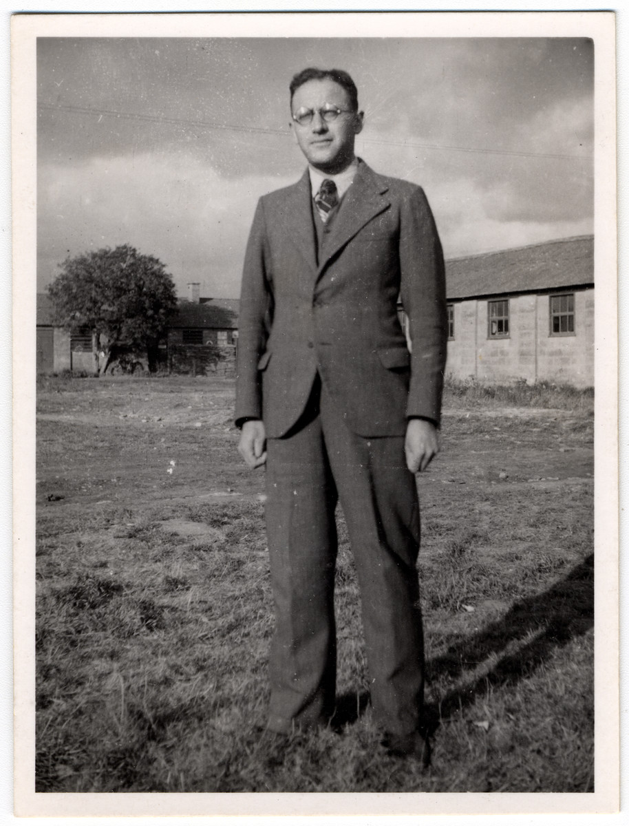 Herbert Hoexter, a German-Jewish refugee, stands on the grounds of the Kitchener refugee camp.