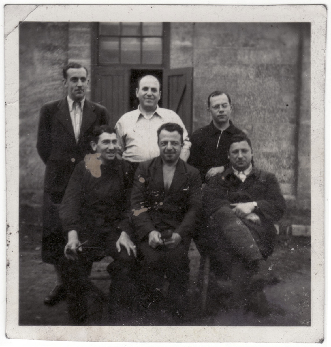 Group portrait of five Jewish men in the Kitchener refugee camp.