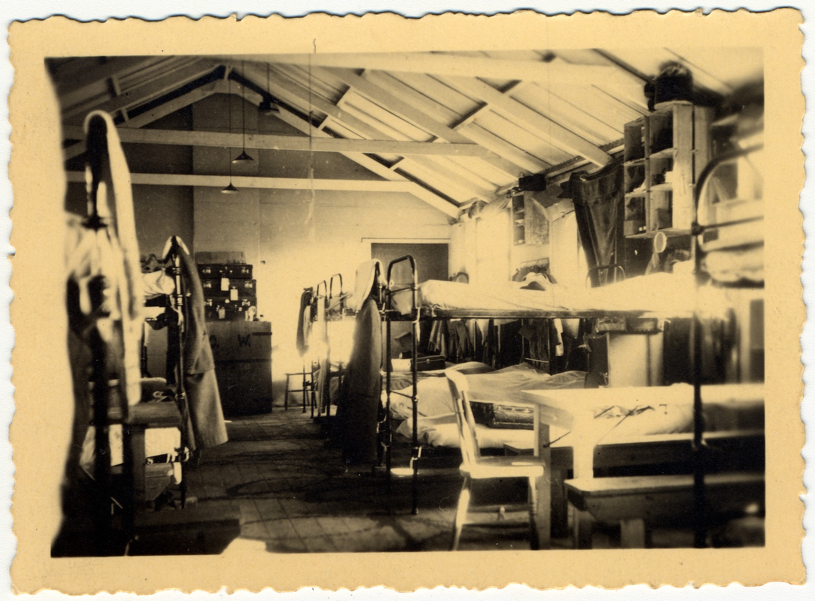 Interior view of the sleeping quarters of hut 41/1 in the Kitchener refugee camp.