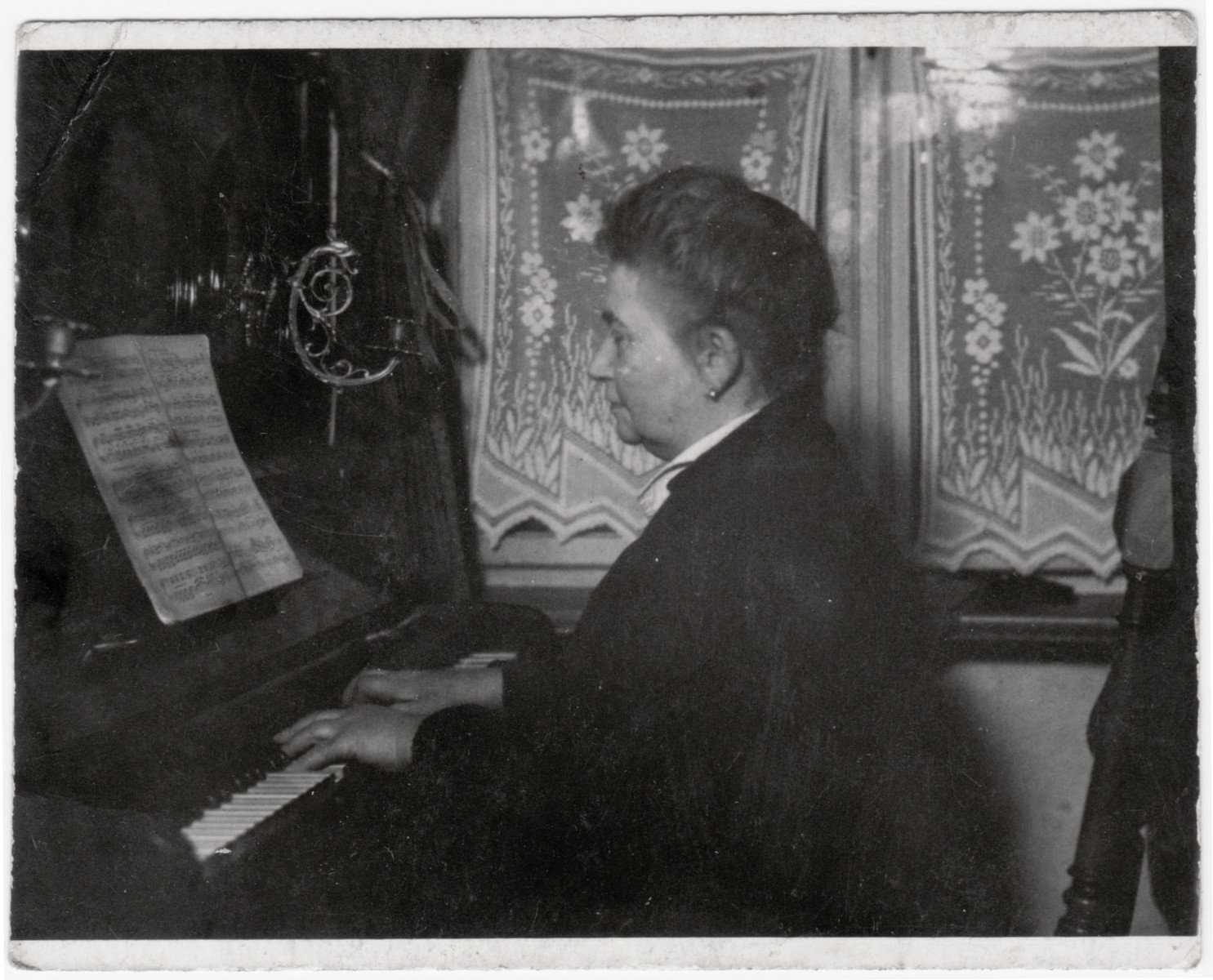 Henriette Bassfreund, the sister of Ismar Bassfreund, plays the piano in her home in Berlin.