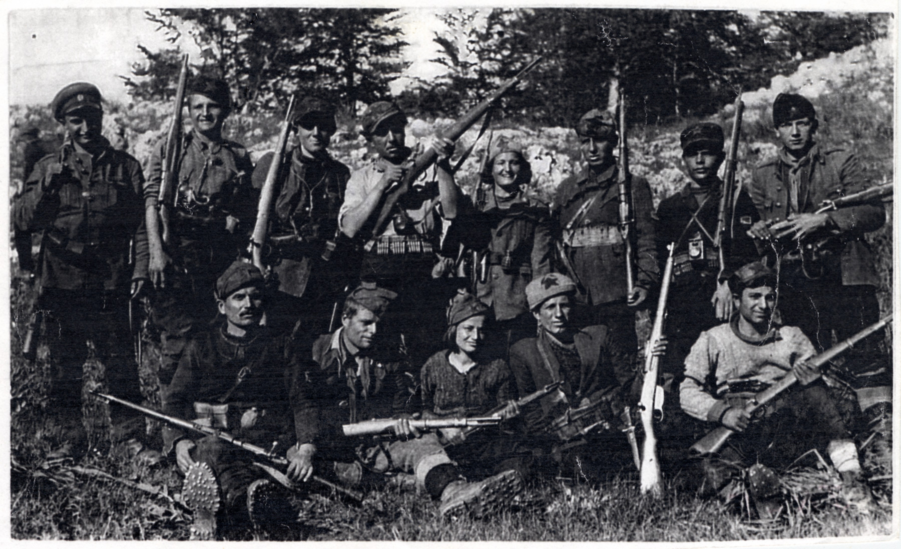 """Macedonian partisans of the detachment """"Damyan Gruev.""""    Among those pictured are Jamila Kolonomos (back row, fourth from the left) and Adela Faradji (seated front row, center)."""