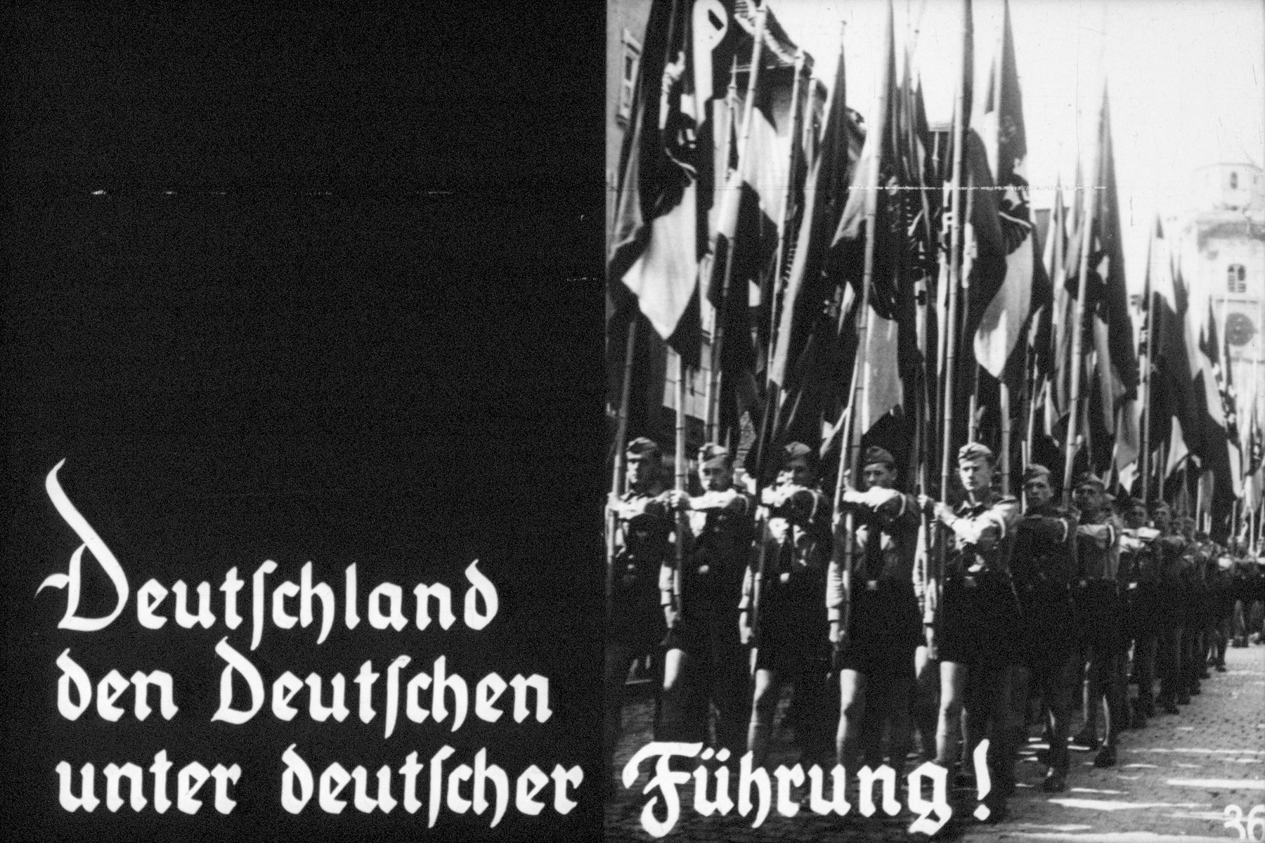 36th slide of Hitler Youth slideshow about the aftermath of WWI and the rise of Nazism.  Deutschland den Deutschen unter deutscher Führung! // Germany for the Germans under German leadership!