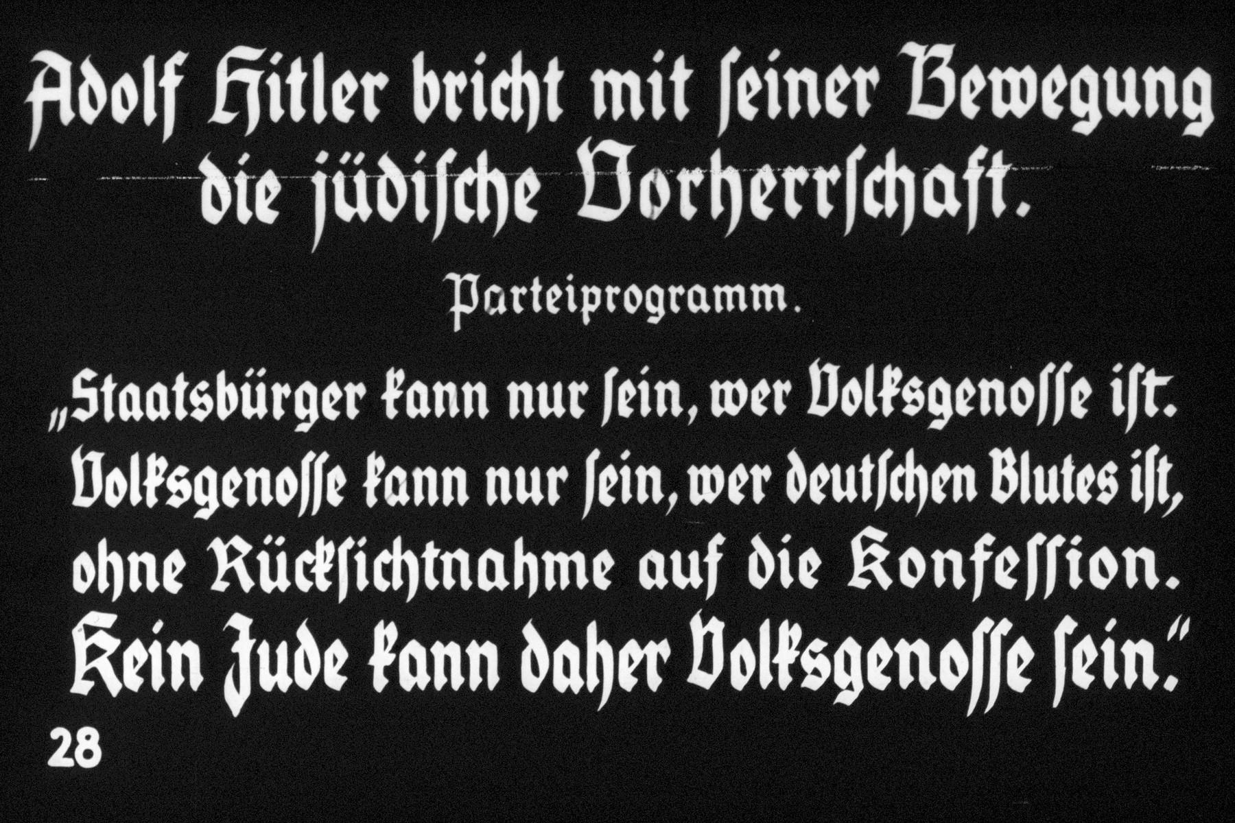 """28th Nazi propaganda slide of a Hitler Youth educational presentation entitled """"Germany Overcomes Jewry.""""  Adolf Hitler bricht mit seiner Bewegung die jüdische Vorherrschaft.  Parteiprogramm. """"Staatsbürger kann nur sein, wer Volksgenosse ist. Volksgenosse kann nur sein wer deutschen Blutes ist, ohne Rücksichtnahme auf die konefession. Kein Jude kann daher Volksgenosse sein.  //  Adolf Hitler breaks Jewish supremacy with his movement.  Party program.  """"Citizen can only be one who is member of the race. Member of the race can only be who is of German blood, without regard to the denomination. No Jew can be a member of the race."""
