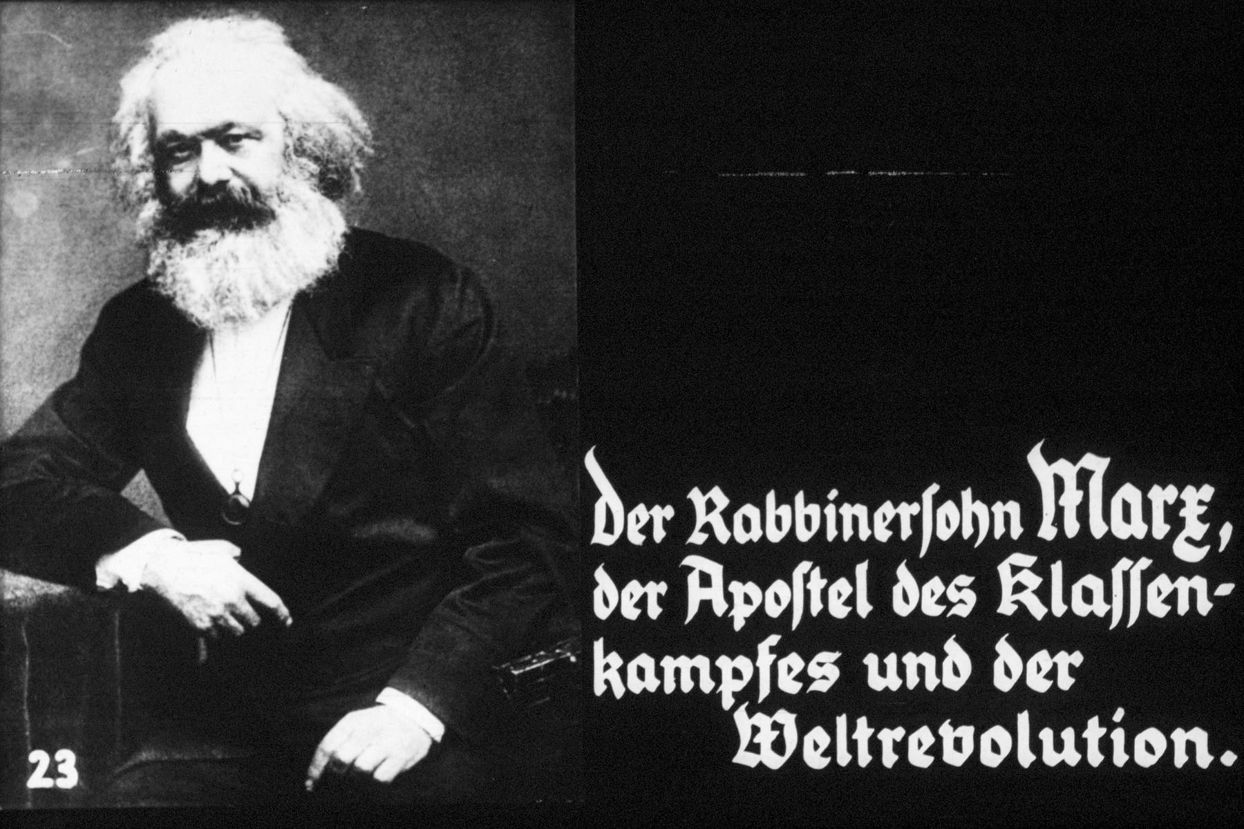 "23rd Nazi propaganda slide of a Hitler Youth educational presentation entitled ""Germany Overcomes Jewry."" der Rabbinersohn Marz, der Apostel des klassenkampfes und der Weltrevolution // the rabbi's son Marx, the apostle of the class struggle and world revolution"