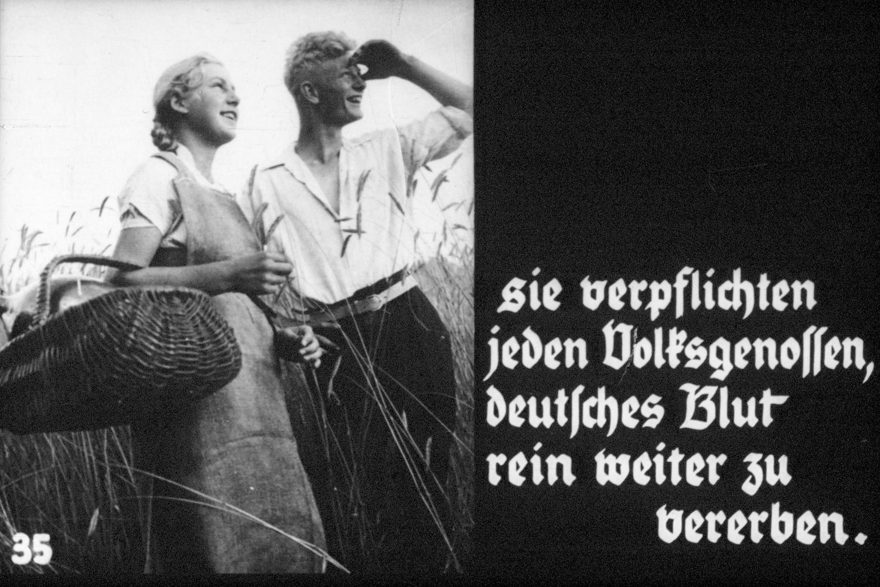 """35th slide Nazi propaganda slide of a Hitler Youth educational presentation entitled """"Germany Overcomes Jewry.""""  sie verpflichten jeden Volksgenossen, deutsches Blut rein weiter zu vererben // they require that each fellow bequeath more purely German blood"""