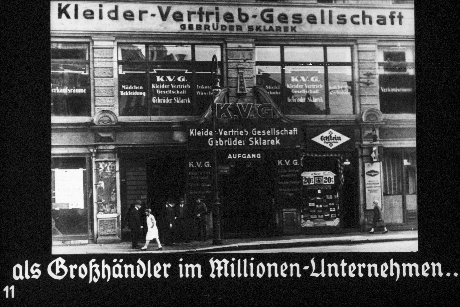"""11th Nazi propaganda slide of a Hitler Youth educational presentation entitled """"Germany Overcomes Jewry.""""  als Großhändler im Millionen-Unternehmen.. // As wholesalers in the millions (worth) companies"""