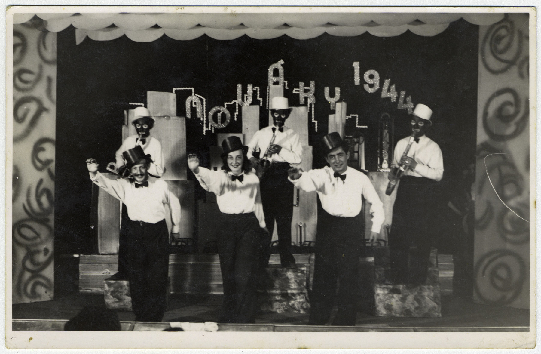 Prisoners put on a musical performance at the Novaky labor camp.   Pictured in the middle is Herta Menzer.