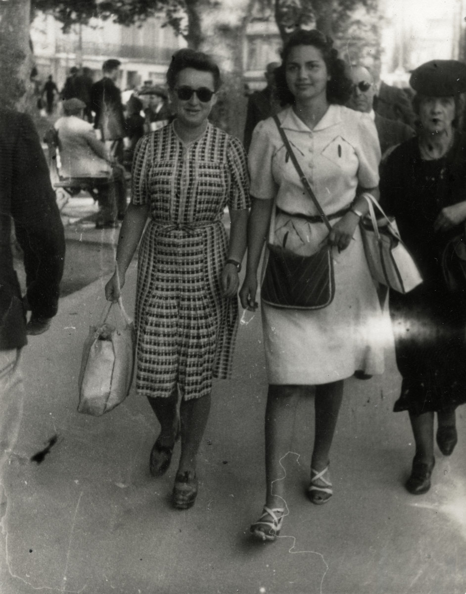 Denise Caraco and her friend Simone Lougassy walk on the Canebiere in Marseilles. Simone belonged to the Eclaireurs Israelites de France youth group.