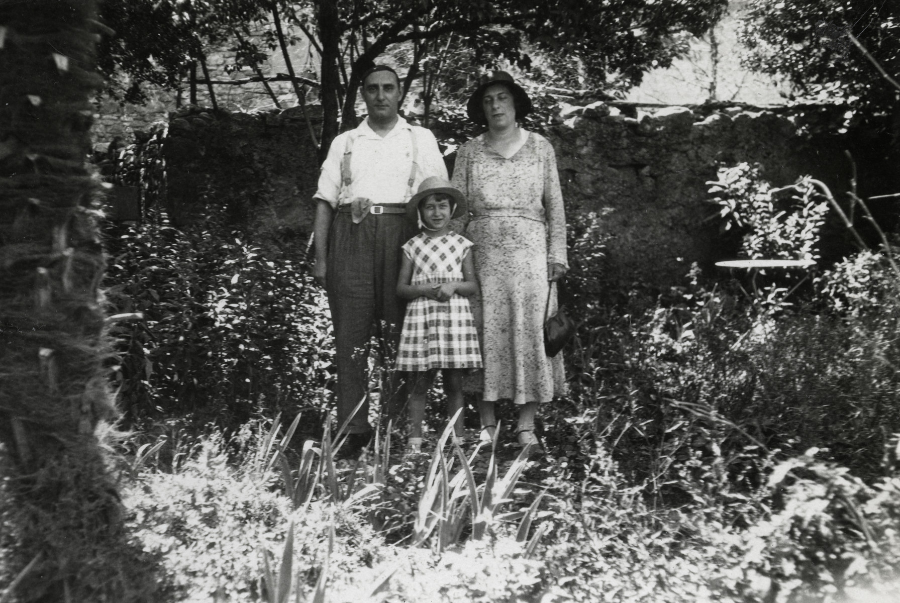 Denise Caraco, her mother Andree and her uncle Emile (her mother's brother) pose in a garden while spending their summer holidays in the village of Dieulefit.