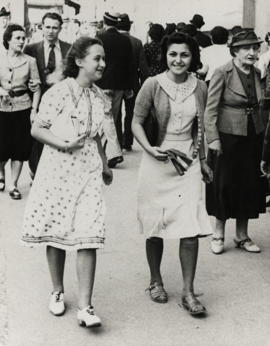 Denise Caraco and her friend Jacqueline Hauser, both members of the Jewish Scouts group, walk on the Canebiere, in Marseilles.
