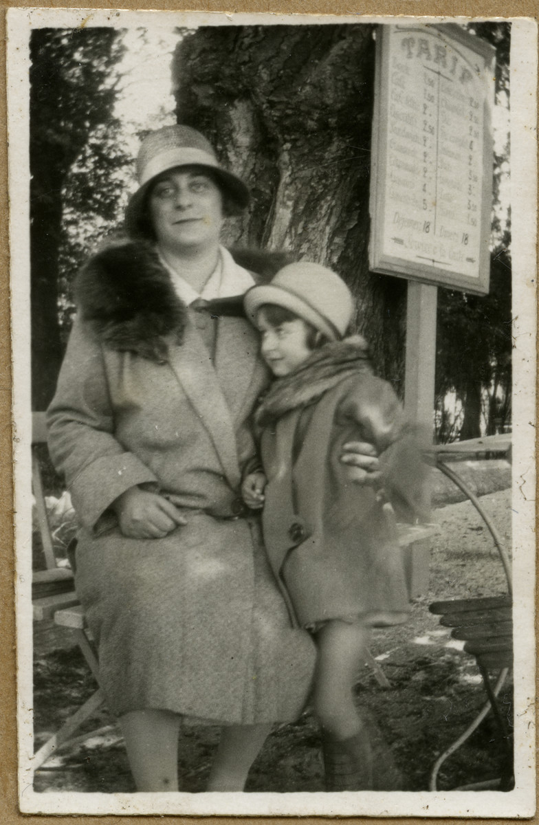 Andree Caraco and her daughter Denise Caraco pose on a bench in a public park.