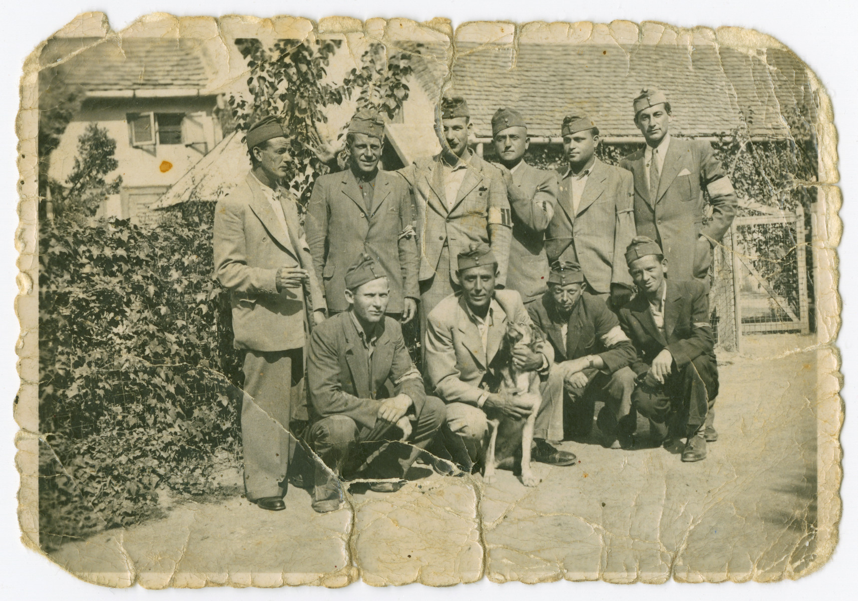 Group portrait of a Jewish forced labor unit.  Lajos Osztreicher is squatting on the left.
