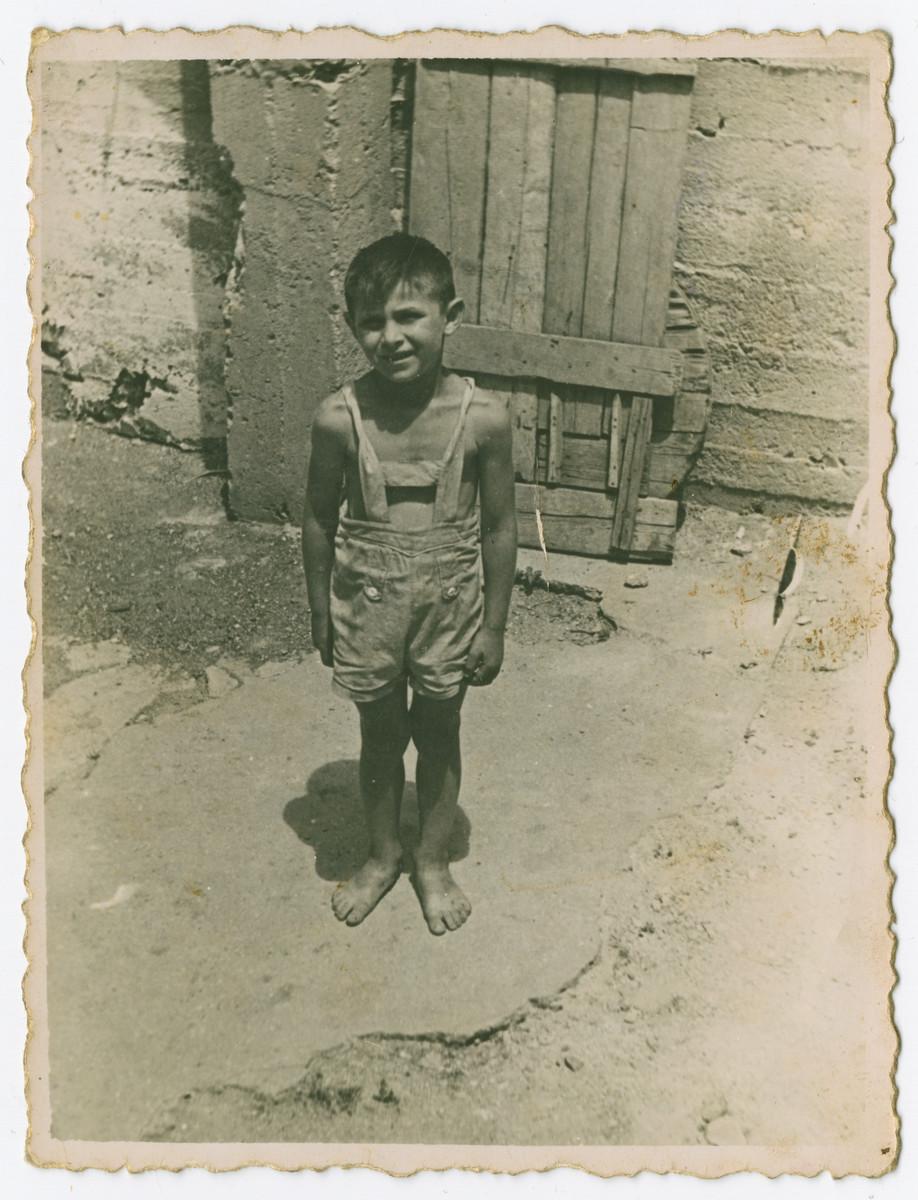 Tibor Osztreicher stands outside barefoot.