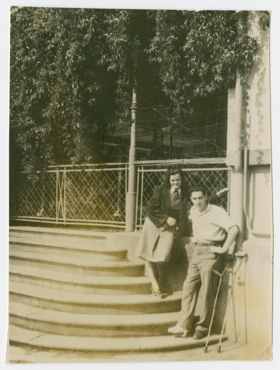 Rachel Gutner and a friend pose on the steps of the Elisabeth Hospital in the Feldafing displaced persons camp.