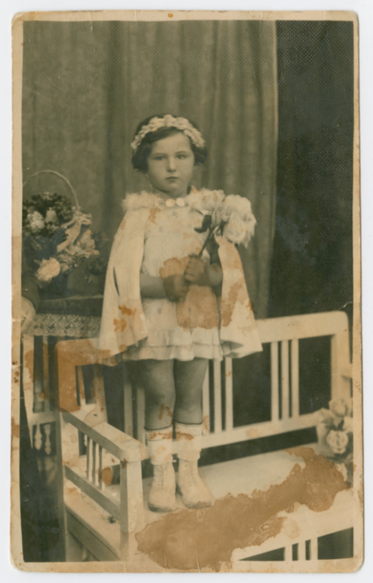 Portrait of Lili Katz taken on Purim only months before she was murdered at Auschwitz.  Lili was the daughter of Friderika Klein's cousin.  She was about five years old when she was killed.