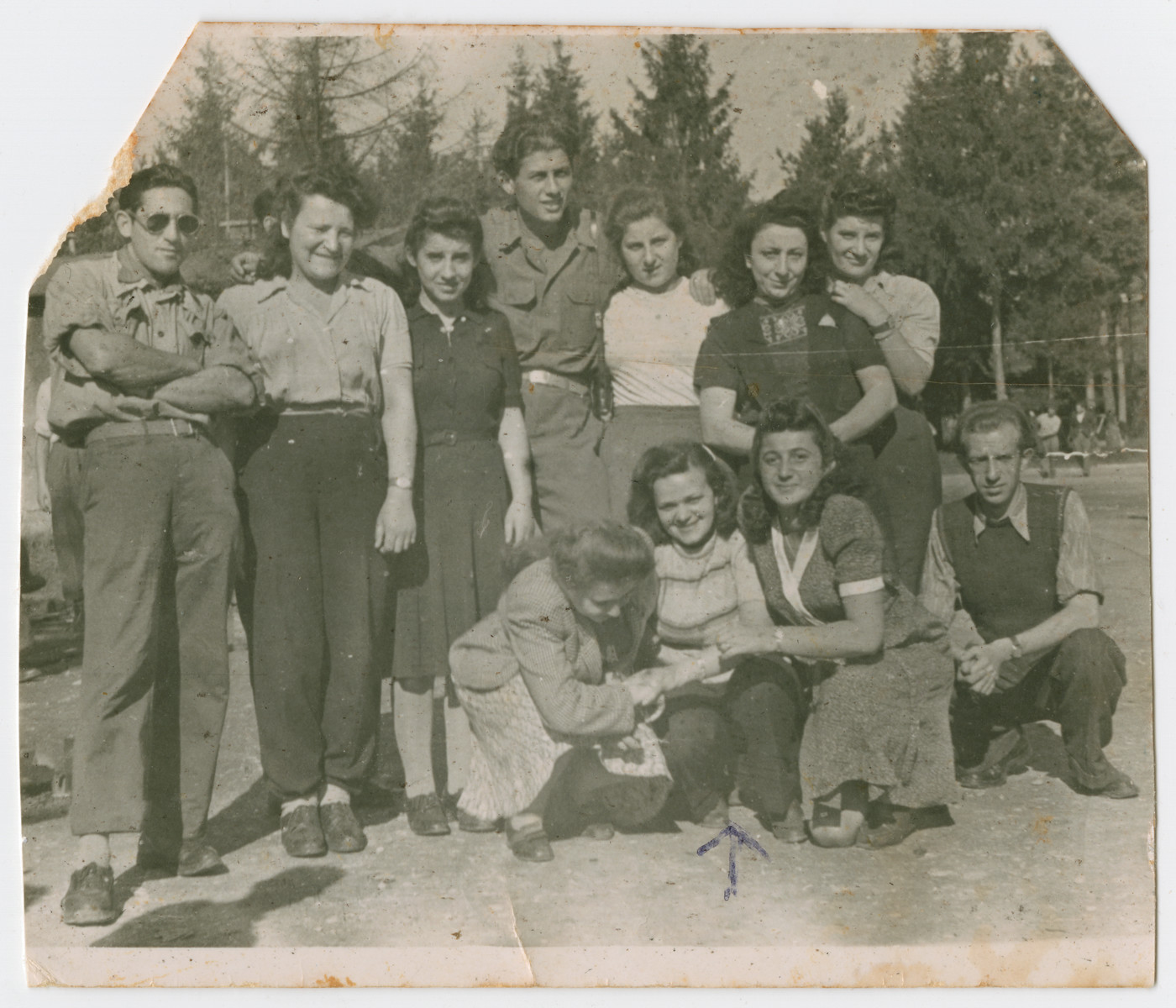 Group portrait of young people in the Feldafing displaced camp prior to their immigration to Israel.  Rachel Gutner is pictured in the center.
