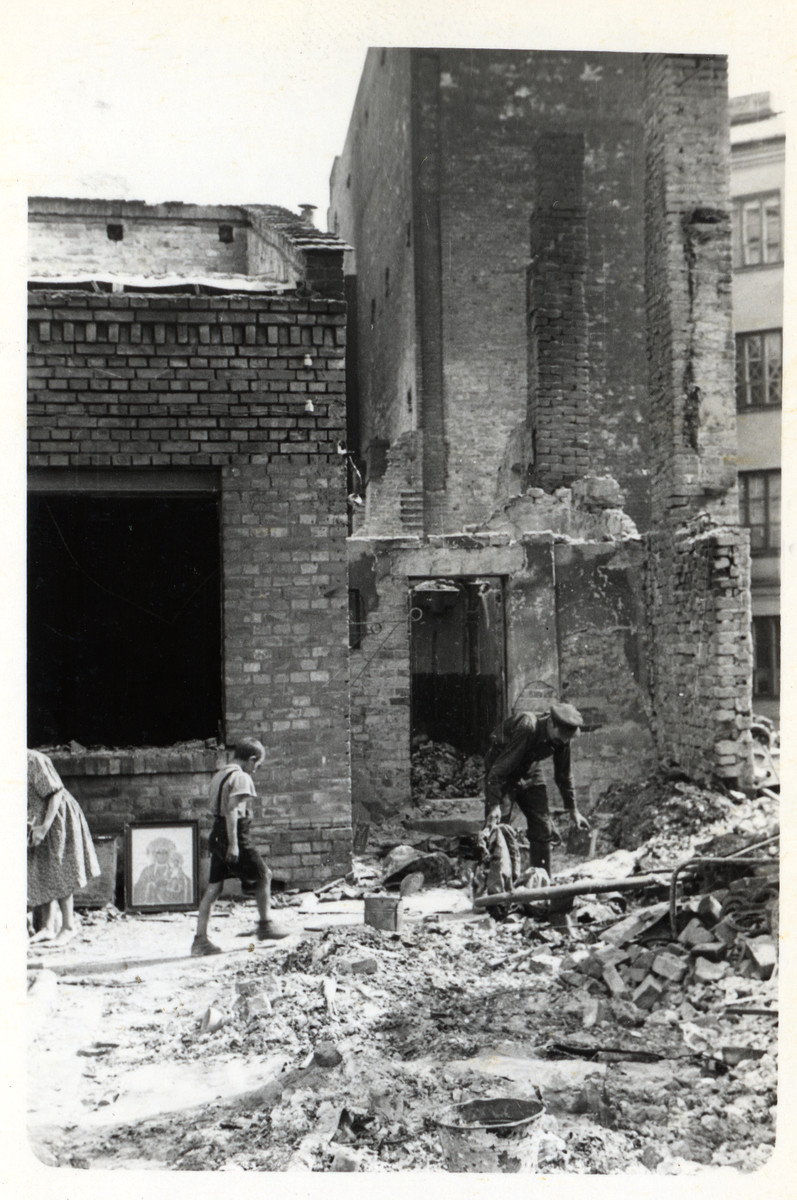 A Polish family picks through the rubble of a bombed out home to find surviving household effects in the besieged city of Warsaw.