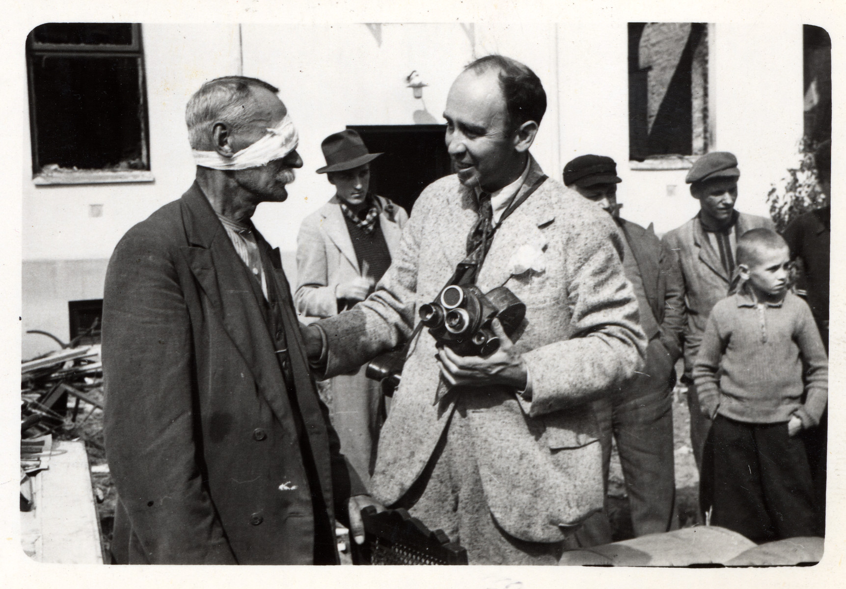 Julien Bryan speaks to a wounded Polish civilian.