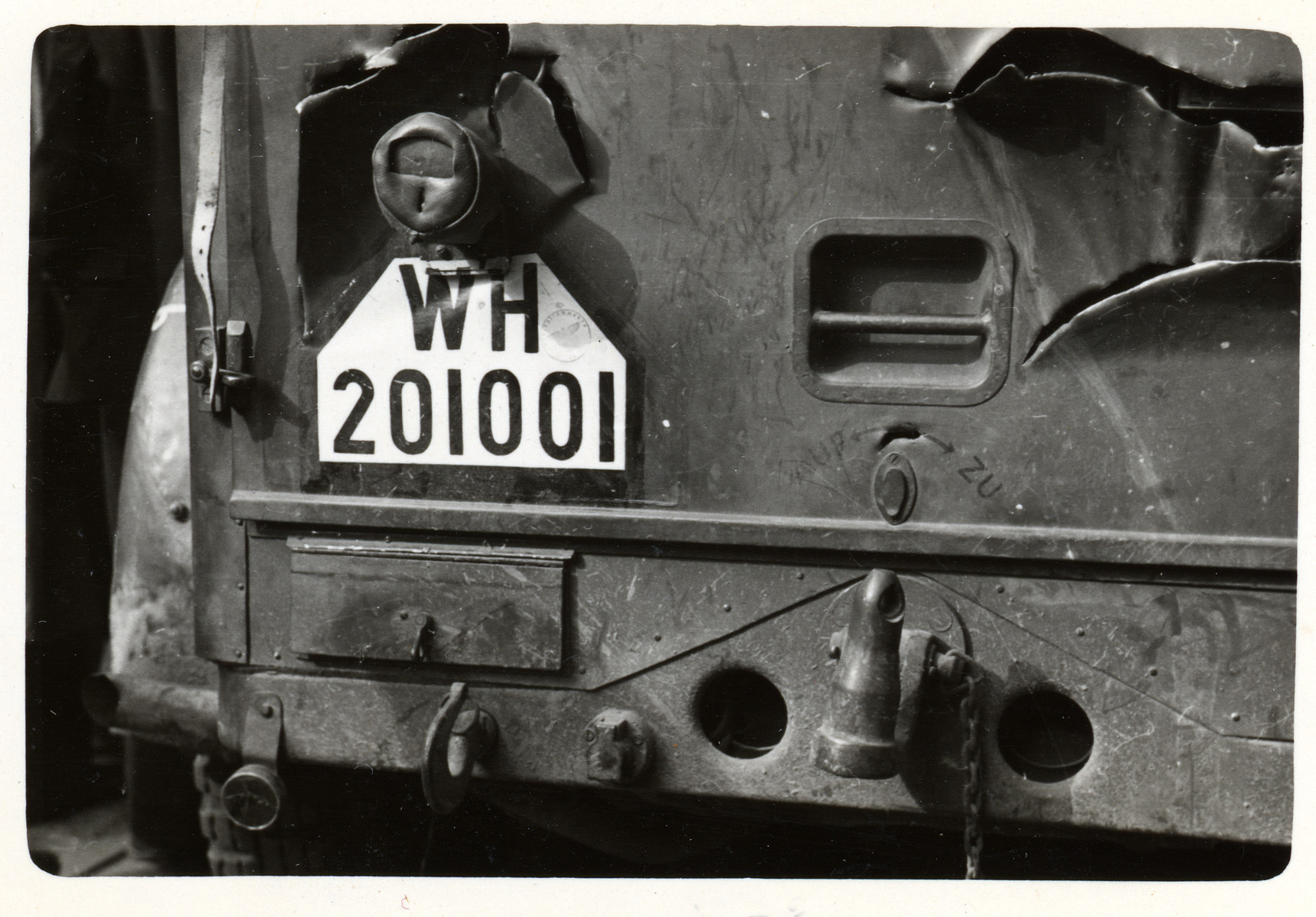 A close-up of the license plate of a military vehicle.