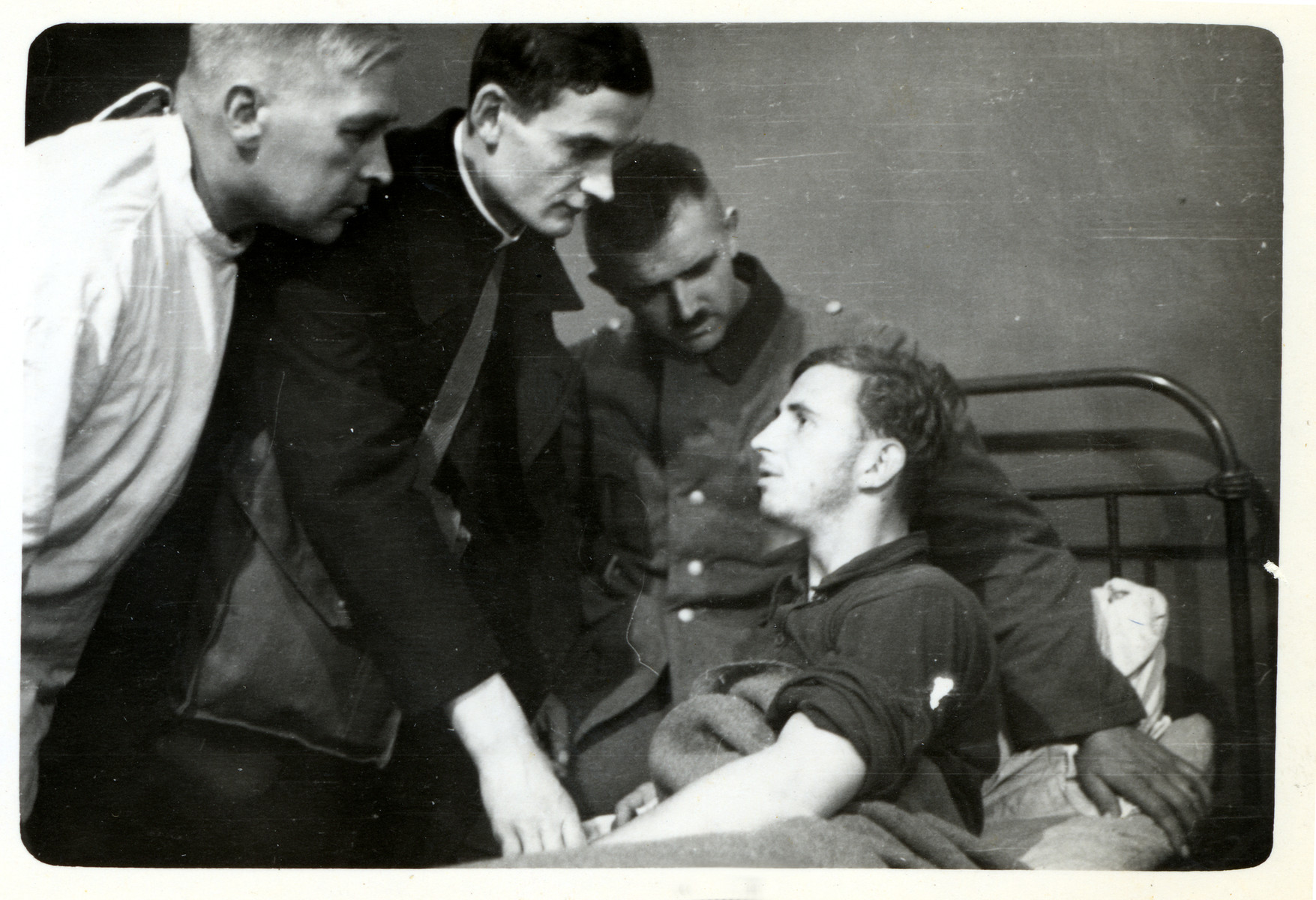A Polish priest visits wounded German POWs in besieged Warsaw.