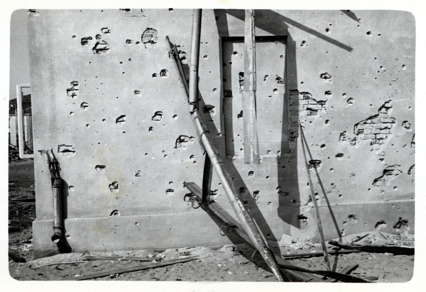 View of a  plaster wall in besieged Warsaw that has been riddled by machine gun fire.
