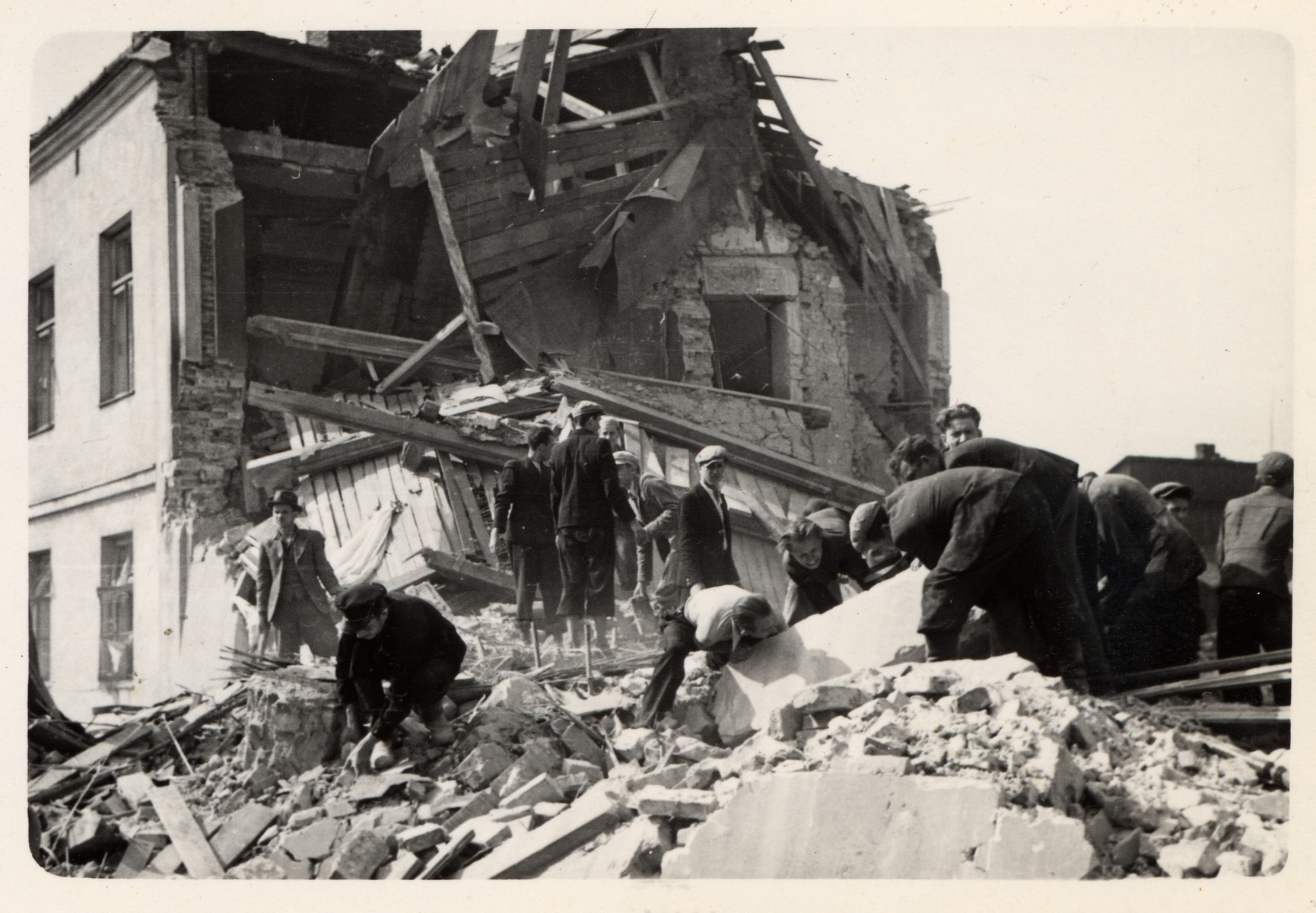 Polish civilians clear the rubble of a bombed out building in besieged Warsaw.
