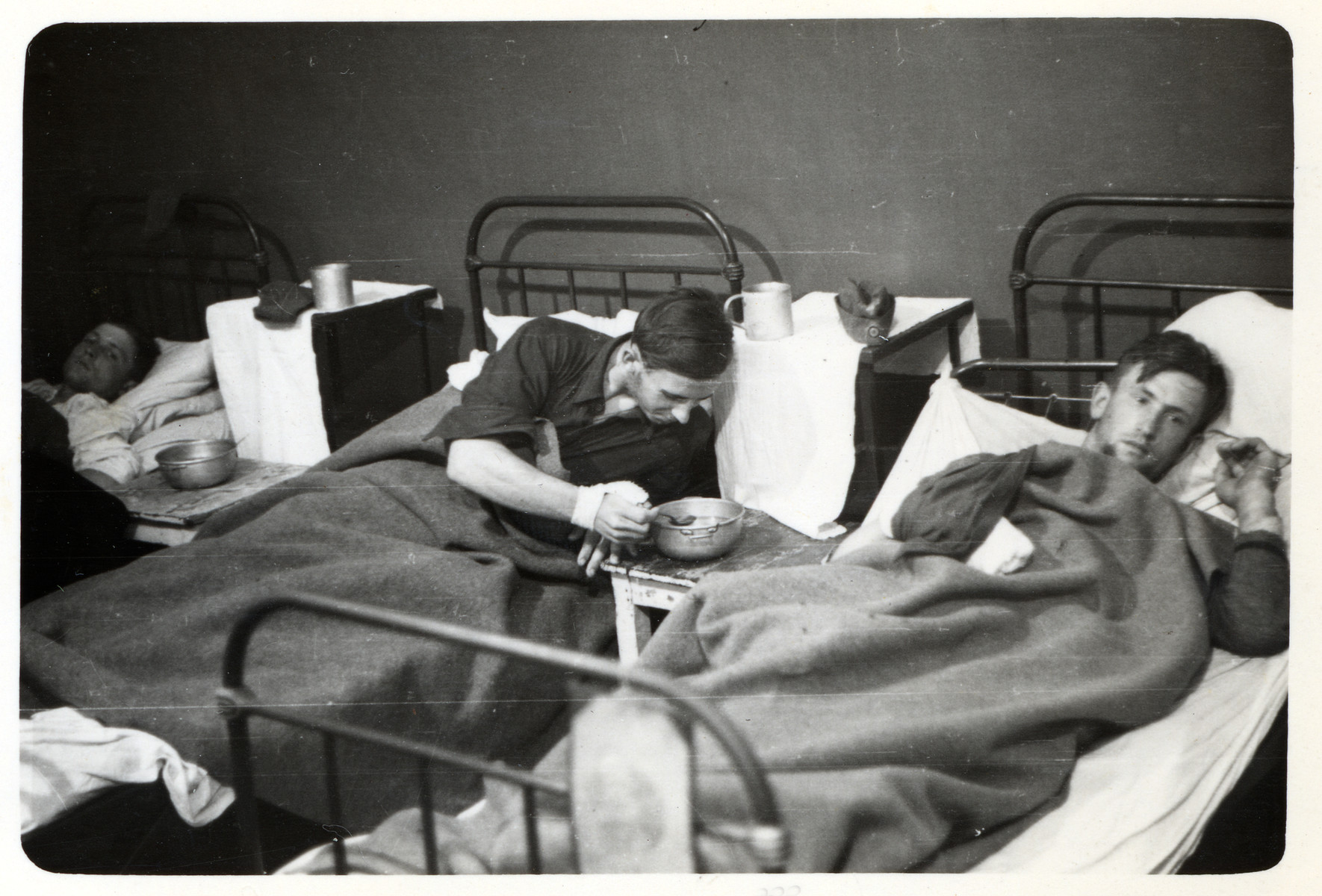Wounded German POWs rest in a makeshift hospital in besieged Warsaw.