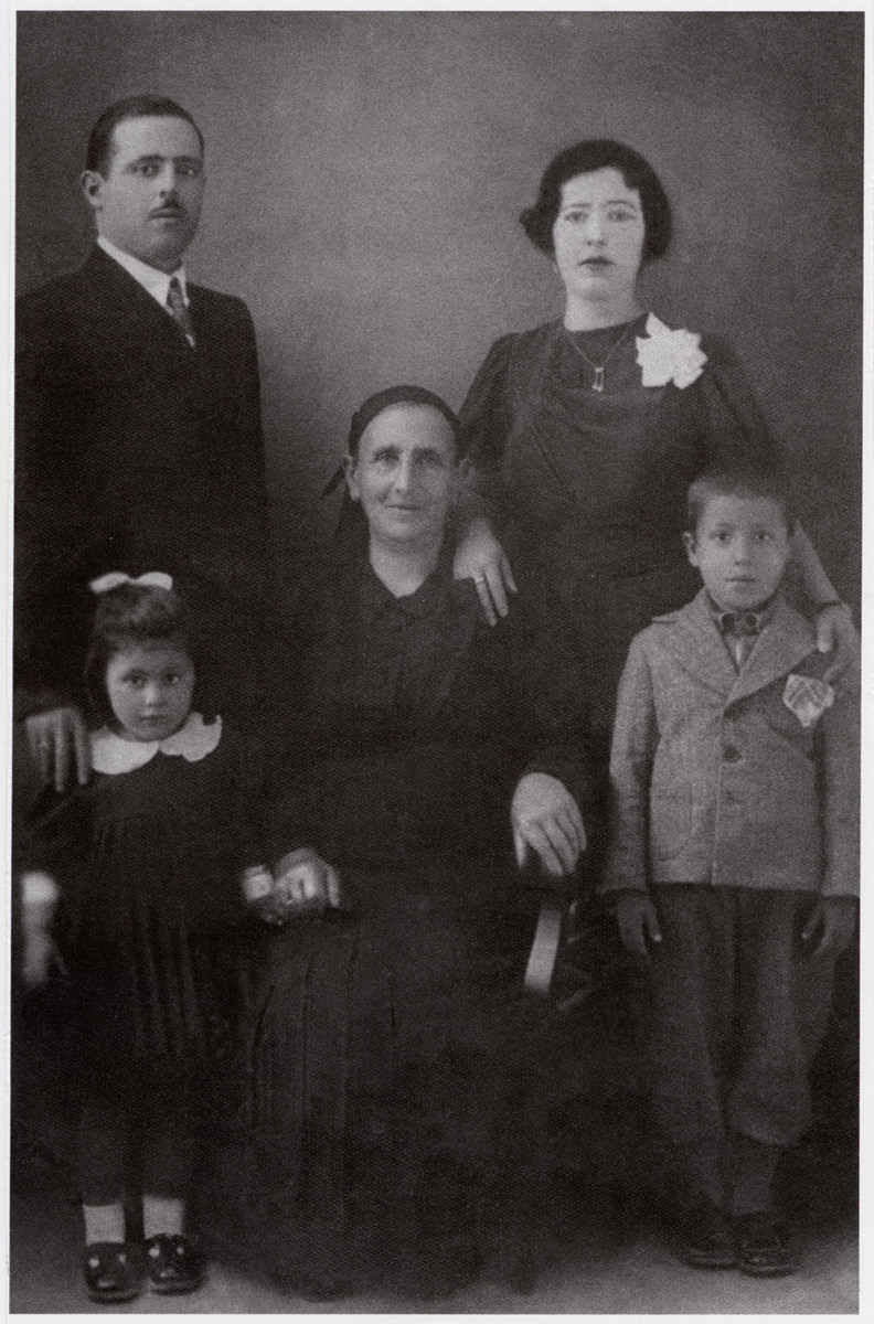 Prewar studio portrait of the Gabrielides family.  Pictured from left to right are Effie, Michael, Simha, Esther and Zino Gabrielides.