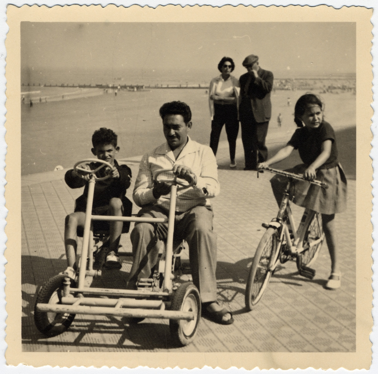 The Sephiha family visits the seaside resort, Le Zout.  Pictured in the cart are Dominique Vidal and his unle Albert.  On the right is his cousin Dany,