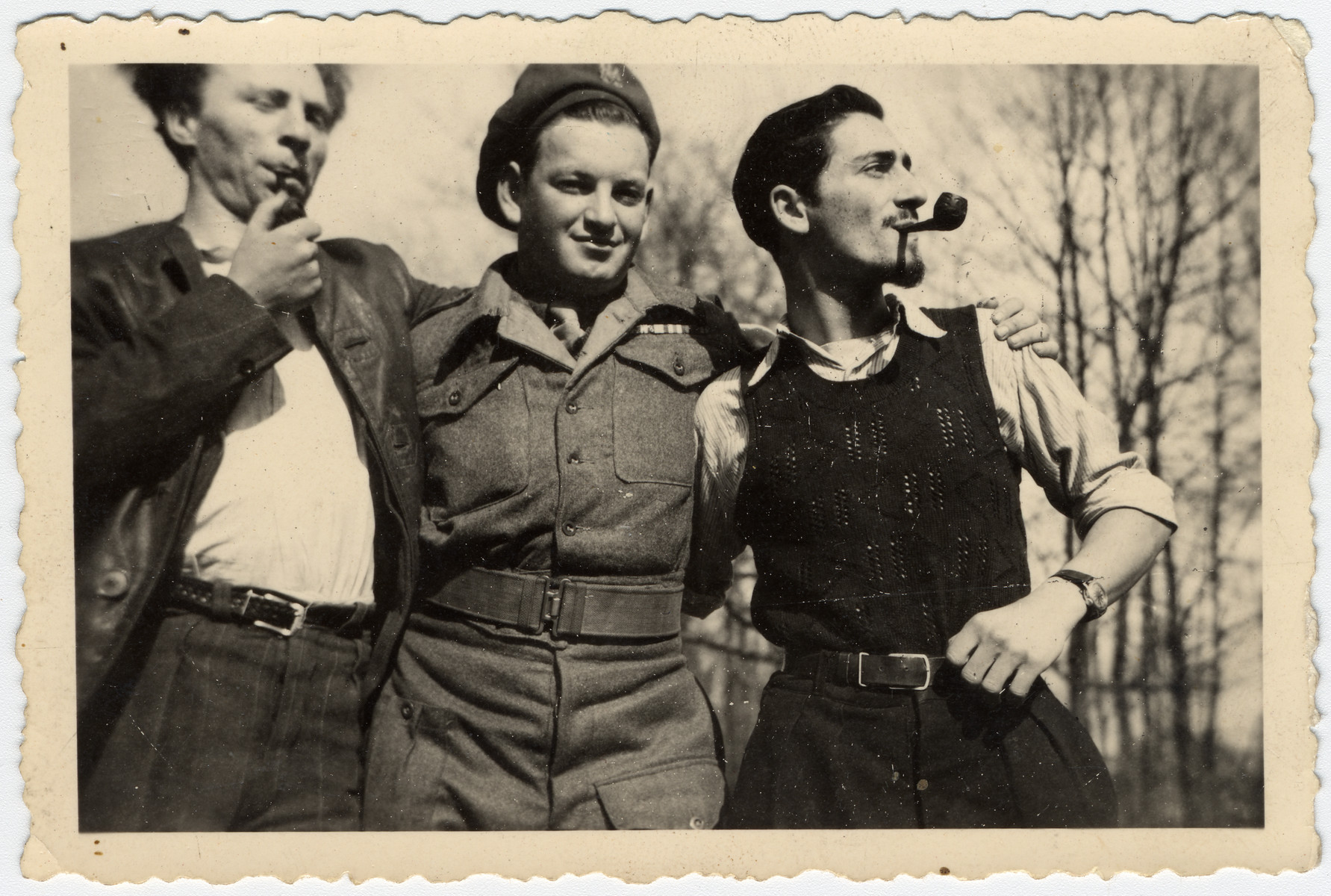 Close-up portrait of three young Israeli men smoking pipes.  Pictured on the right is Jacques Sephiha.  The man in the center is a member of the Jewish Brigade.