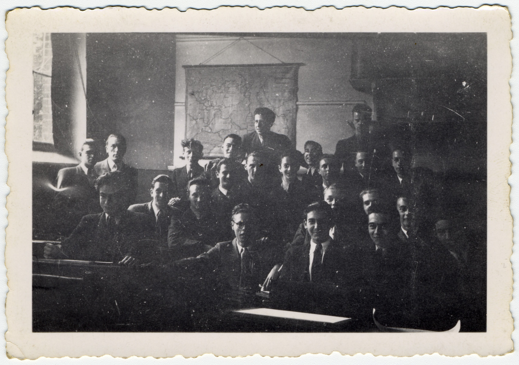 Group portrait of male students at the Lycee Athenee de Saint-Gilles.  Haim Sephia is seated in the front row, third from the right. Also pictured are Adam Joseph and Marcel Brodthaers on the far right.