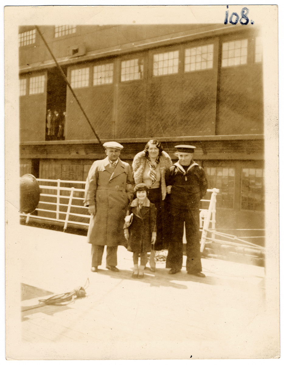 Zysia, Hinda and Sonia Pressman with a sailor on board the S.S. Westernland in April 1934 en route to the United States.