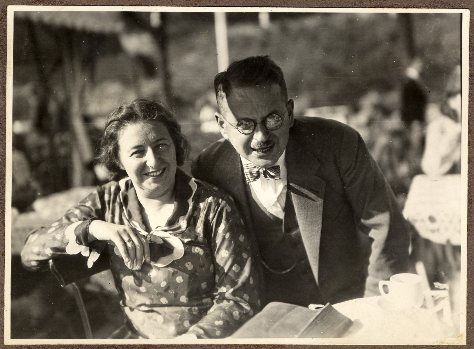 A German Jewish couple poses in an outdoor cafe.  Pictured are Dr. Hans Adolf and Augusta Bujakowksi.