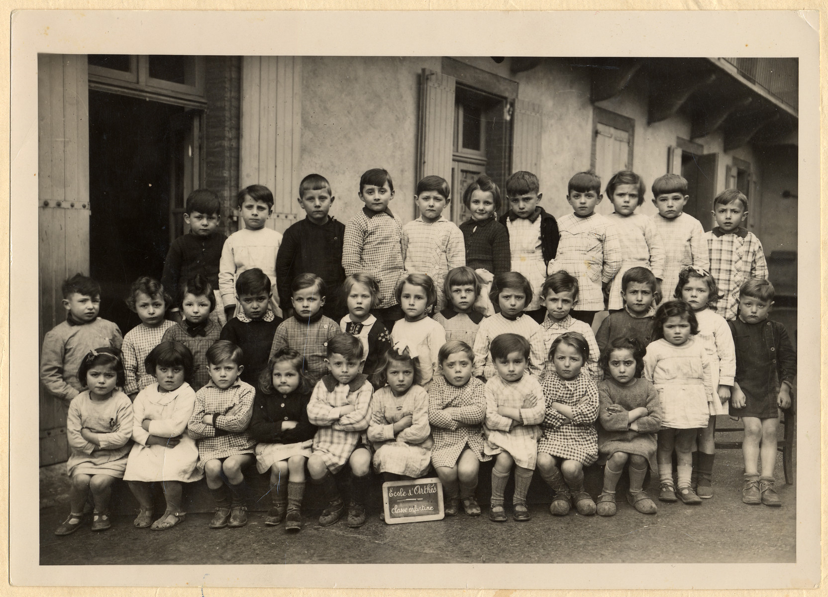 Class portrait of a kindergarten in Paris.  Among those pictured is Stephanie Bujakowski (second row, sixth from the left).  She was murdered a few years later in Auschwitz.